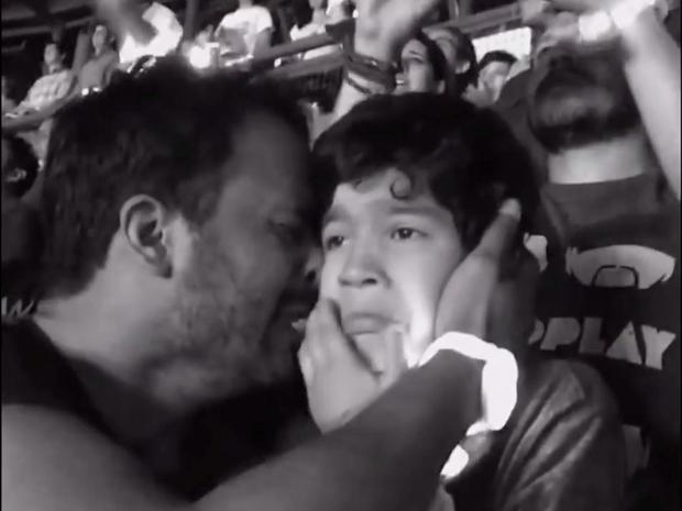 A young autistic boy is overcome with emotion when Coldplay play his favourite song
