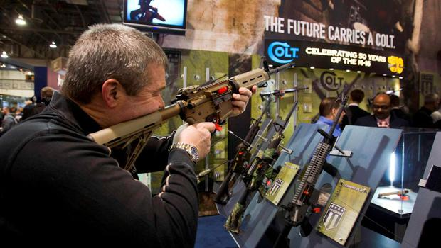 Mark Heitz, of Tactical Firearms in Kingston, New Hampshire, looks over a civilian version of the Colt M4 carbine during the annual SHOT (Shooting, Hunting, Outdoor Trade) Show in Las Vegas, in this file photo taken January 15, 2013. Famed U.S. gun maker Colt appears to be headed into a bankruptcy duel in the coming week if its private equity backers and bondholders cannot overcome widely differing views on the best way to heal the company's financial wounds.  REUTERS/Las Vegas Sun/Steve Marcus/Files