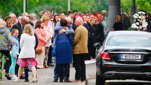 The parents of Ana Kriegel, Patrick and Geraldine are comforted at their daughters funeral mass in Newlands Cross Crematorium in Dublin. Pic:Mark Condren