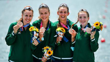 Ireland rowers, from left, Aifric Keogh, Eimear Lambe, Fiona Murtagh and Emily Hegarty celebrate on the podium with their bronze medals after finishing 3rd place in the Women's Four final. Photo: Seb Daly/Sportsfile