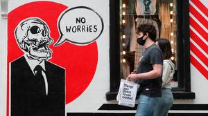 People wearing masks in Dublin city centre. Photo: Niall Carson/PA Wire