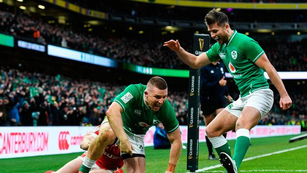 Andrew Conway celebrates after scoring Ireland's bonus-point try against Wales. Photo by Ramsey Cardy/Sportsfile