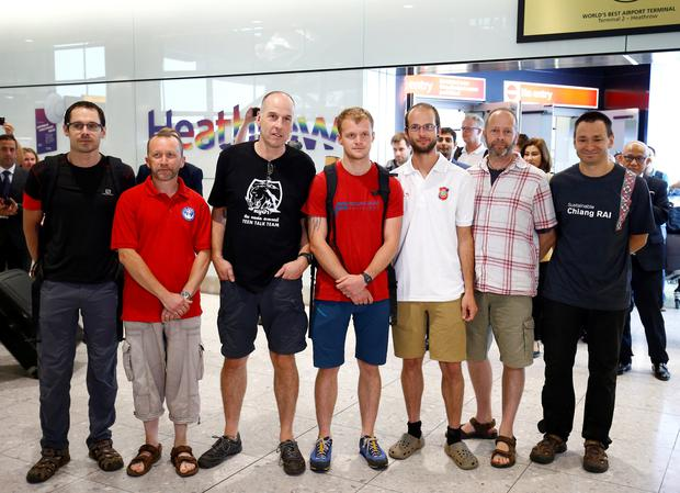 British cave divers, Rick Stanton, Chris Jewell, Connor Roe, Josh Bratchley, Jim Warny, Mike Clayton and Gary Mitchell, arrive back at Heathrow Airport, having helped in the rescue of the 12 boys in Thailand, in London, Britain, July 13, 2018. REUTERS/Henry Nicholls