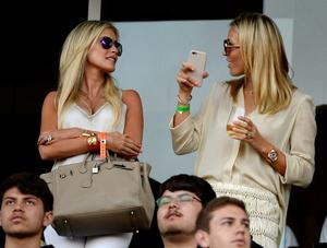 Alex Curran (L) wife of new Los Angeles Galaxy midfielder Steven Gerrard and Claudine Keane wife of Los Angeles Galaxy forward Robbie Keane stand in the owner's box before Gerrard is introduced in front of fans during halftime against Toronto FC on July 4, 2015 at StubHub Center in Carson, California. The former Liverpool captain Steven Gerrard is scheduled to play his first MLS match on Friday, July 17 at StubHub Center against San Jose Earthquakes. (Photo by Kevork Djansezian/Getty Images)