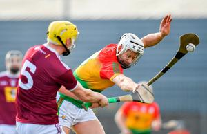 Carlow's Jack Kavanagh blocks a pass from Westmeath's Aaron Craig. Photo: Seb Daly/Sportsfile