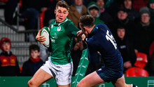 Jack Crowley of Ireland avoids the tackle of Ollie Smith of Scotland on his way to scoring his side's third try. Photo: Harry Murphy/Sportsfile