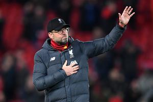 Jurgen Klopp acknowledges the fans after his side were knocked out of the Champions League by Atletico Madrid (Photo by Laurence Griffiths/Getty Images)