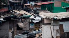 Residents reinforce the roof of their house by putting heavy tires at a slum area in Manila on September 14, 2018.  (Photo by NOEL CELIS / AFP)NOEL CELIS/AFP/Getty Images