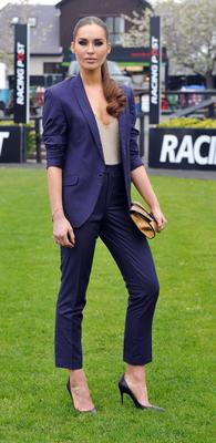 Fashionista Roz Purcell in a Scribe by Roz suit she designed