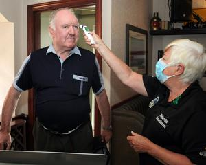 Local man Jack Woulfe getting his temperature                 checked by Pauline Whelan of Whelans Pub in Newcastle                 west, Co Limerick. Picture Brendan Gleeson