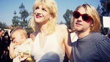 Kurt Cobain of Nirvana (right) with wife Courtney Love and daughter Frances Bean Cobain at the Universal Ampitheater