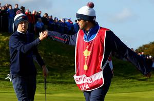 U.S. Ryder Cup player Jordan Speith (L) celebrates with his caddie Michael Greller on the seventh green after winning the hole during his fourballs 40th Ryder Cup match at Gleneagles in Scotland September 26, 2014.      REUTERS/Eddie Keogh (BRITAIN  - Tags: SPORT GOLF)