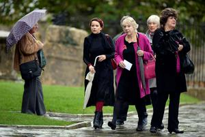 Julia Sawalha (second left) and fellow mourners arriving for the funeral of Lynda Bellingham at St Bartholomew's Church in Crewkerne, Somerset  Andrew Matthews/PA Wire