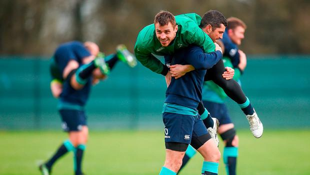 Rob Kearney of Ireland carries teammate Tommy Bowe during squad training at Carton House in Maynooth, Co. Kildare. Photo by Seb Daly/Sportsfile