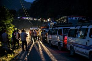 People gather on a road as traffic is affected by a landslide caused by an earthquake, in Kurintar, Nepal April 27, 2015.  REUTERS/Athit Perawongmetha