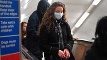 A woman at Green Park station on the London Underground tube network wearing a protective facemask. Photo: Kirsty O'Connor/PA Wire