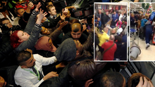 Shoppers battle for the check-out on Black Friday in London (Inset: Chaotic scenes in an Irish supermarket)