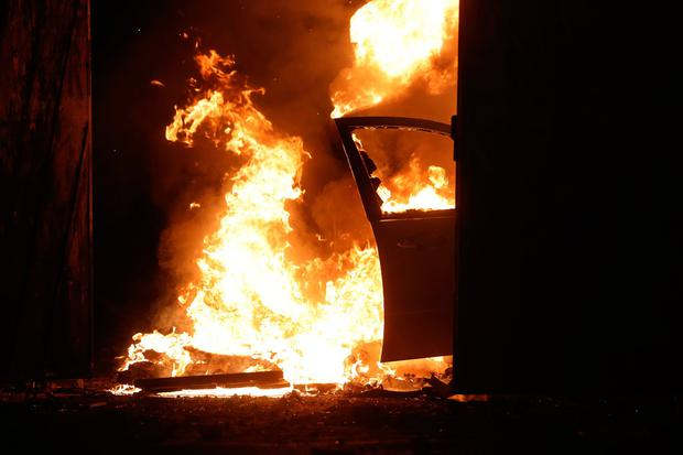 A car on fire at the Peace Gates in Lanark Way, Belfast during further unrest in Belfast. Picture date: Wednesday April 7, 2021. PA Photo. The cause of the unrest has been attributed to frustration over a decision not to prosecute members of Sinn Fein over alleged coronavirus regulation breaches at the funeral of republican Bobby Storey. See PA story ULSTER Disorder. Photo credit should read: Liam McBurney/PA Wire