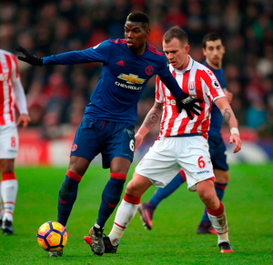 Stoke City's Glenn Whelan (right) and Manchester United's Paul Pogba battle for the ball during the Premier League match at the Bet365 Stadium. Photo: Nick Potts/PA