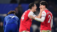 Arsenal's Granit Xhaka and Hector Bellerin celebrate after the game at Stamford Bridge last night. Photo: Getty Images