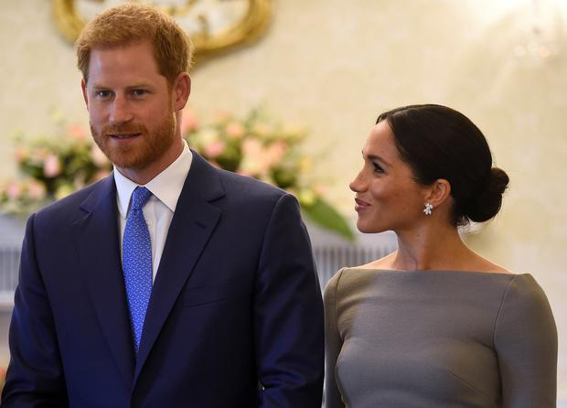 Britain's Prince Harry and his wife Meghan, Duchess of Sussex, smile as they prepare to meet Ireland's President, Michael Higgins, on their second day of a two-day visit to Dublin, Ireland July 11, 2018. REUTERS/Clodagh Kilcoyne