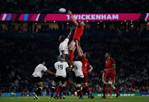 England's flanker Tom Wood (C) beats Fiji players to the ball in a line-out in the Rugby World Cup. AFP PHOTO / ADRIAN DENNIS.