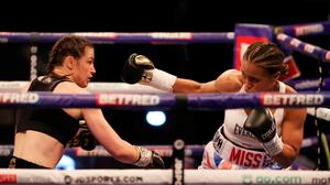 Katie Taylor, left, in action against Natasha Jonas during their WBC, WBA, IBF and WBO female lightweight title fight  at the Manchester Arena in Manchester, England. Photo by Mark Robinson / Matchroom Boxing via Sportsfile