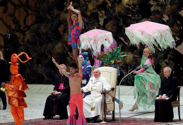 Pope Francis watches artists from Circus Aqua during the weekly general audience at the Vatican, January 8, 2020. REUTERS/Remo Casilli