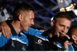 23 September 2013; Dublin's Eoghan O'Gara, right, and Paul Flynn during the homecoming celebrations of the All-Ireland Senior Football Champions. Merrion Square, Dublin. Picture credit: David Maher / SPORTSFILE