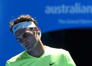 Roger Federer reacts during his defeat to Italy's Andreas Seppi at the Australian Open.