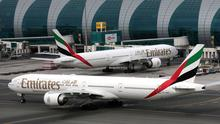 Grounded: Emirates planes at Dubai International Airport in United Arab Emirates. The airline closed routes as of Monday this week. Photo: Christopher Pike/Reuters
