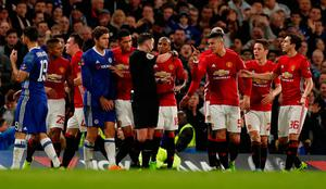 Manchester United's Marcos Rojo and teammates remonstrate with referee Michael Oliver after Ander Herrera was shown a red card. REUTERS