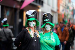 Two women in clover patterned face masks near the Temple bar in Dublin, on St Patrick's day. PA Photo. Picture date: Tuesday March 17, 2020. See PA story HEALTH Coronavirus. Photo credit should read: Niall Carson/PA Wire