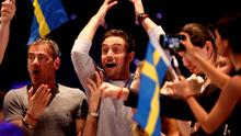Sweden's Mans Zelmerlow (C) celebrates winning the 60th Eurovision Song Contest final on May 23, 2015 in Vienna.  AFP PHOTO / DIETER NAGLDIETER NAGL/AFP/Getty Images