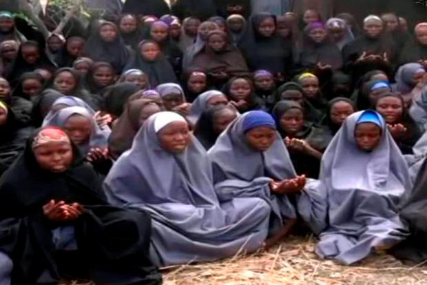 A screengrab taken from a video showing the abducted girls in full-length hijab, praying in an undisclosed location Photo: AFP/Getty
