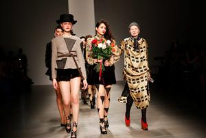 Designer Vivienne Westwood, right, walks with models on the runway after the Vivienne Westwood Red Label show at London Fashion Week