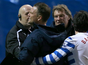 Clint Hill confronts jeering QPR fans after the game