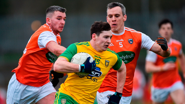 Donegal's Jamie Brennan attempts to get away from Armagh duo Ryan McShane and Mark Shields during their clash at Healy Park. Photo by Oliver McVeigh/Sportsfile