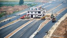 A three-storey nail house, the last building in the area, with a Chinese national flag on its rooftop is seen in the middle of a newly-built road in Luoyang, Henan province, China