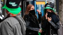 Tourists near O'Connell Street in Dublin, on St Patrick's day. PA Photo. Picture date: Tuesday March 17, 2020. See PA story Niall Carson/PA Wire