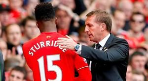 Liverpool's Daniel Sturridge shakes hands with manager Brendan Rodgers as he is substituted