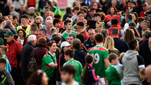 A large Mayo support comes on to the field to mingle with the players after win over Down