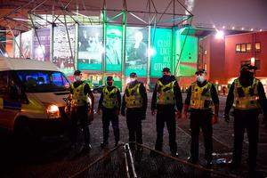 Police are seen outside Celtic Park during protests after the Betfred Cup match between Celtic and Ross County. (Photo by Mark Runnacles/Getty Images)
