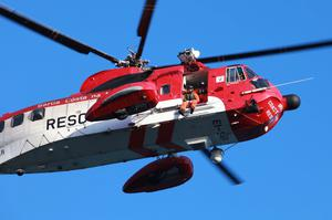 The Coastguard helicopter was involved in the search for the three men