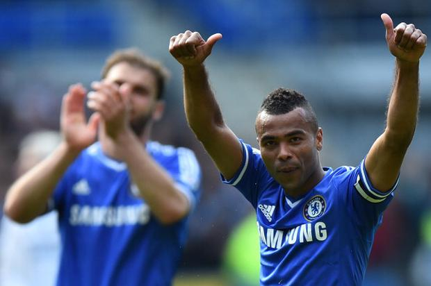 Chelsea's English defender Ashley Cole gestures to Chelsea fans following the English Premier League football match between Cardiff City and Chelsea at the Cardiff City Stadium in Cardiff on May 11, 2014. Chelsea won 2-1. AFP PHOTO/BEN STANSALL -