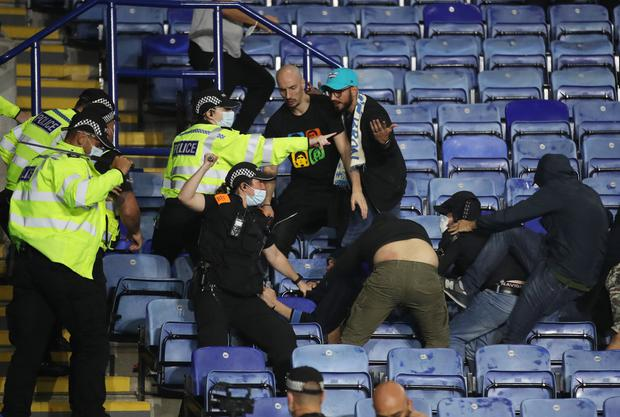 Police move in to sort out rival fans. Photo: Reuters