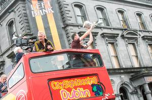 7/9/2015: TJ Reid and Joey Holden are holding the Liam McCarthy Cup as the bus makes the journey to Nowlan Park during the homecoming for the Kilkenny team. Photo: Pat Moore.