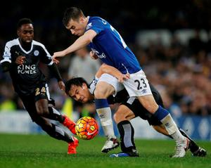Leicester's Shinji Okazaki tries to make the tackle against Everton's Seamus Coleman. Photo: Phil Noble/Reuters