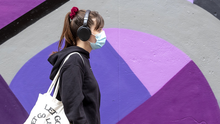 A woman wearing a protective face mask in Dublin's Temple Bar. Photo: Collins Photos