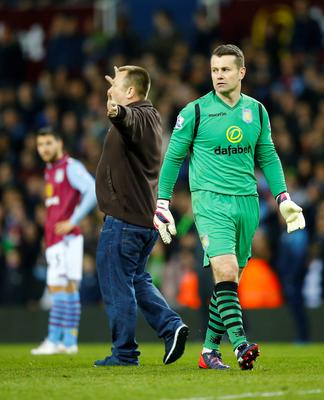 Aston Villa's Shay Given as a fan invades the pitch during the match Reuters / Darren Staples